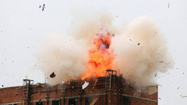 PORTENT: An explosion is seen after a Chinese military drone dropped a bomb on the roof of a building during an ...