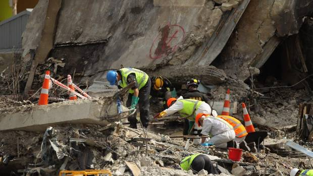 Search and rescue teams scour through the wreckage of the CTV building following the 2011 Christchurch quake. The post ...