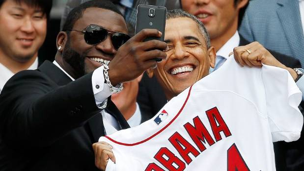 SPONSORED: Boston Red Sox designated hitter David 'Big Papi' Ortiz takes a selfie with US President Barack Obama.