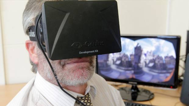 STRAPPED IN: Reporter Dave Burgess rides a virtual rollercoaster using the Oculus Rift virtual reality headset.