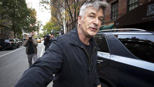 Actor Alec Baldwin was booted off a flight for refusing to stop playing games on his cellphone.