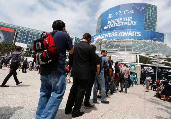 People stand in line to enter the 2014 Electronic Entertainment Expo in LA.