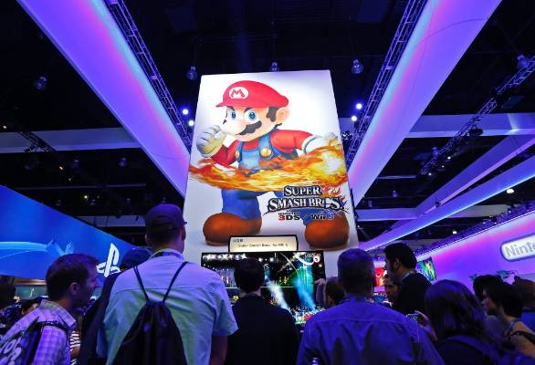 Gamers gather around a new Nintendo Super Smash Bros for Wii U at the 2014 Electronic Entertainment Expo.