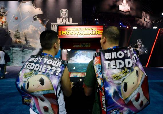 Gamers play play a classic arcade game Michael Jackson's Moonwalker at the 2014 Electronic Entertainment Expo.