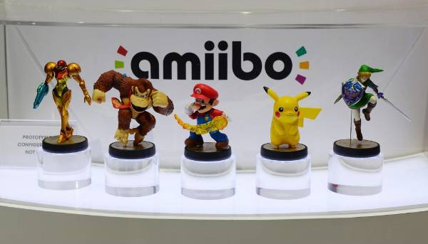 Amiibo toy figures that will work in tandem with its games are displayed at the Nintendo booth at E3 2014.