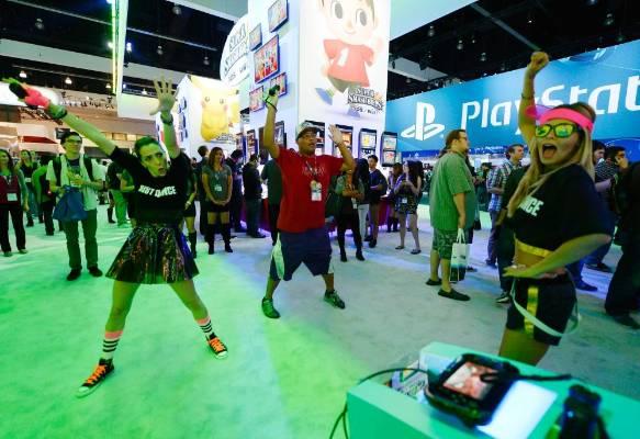 Ubisoft employees Jen Galassao, Kelly Koski and attendee Joh Yamamoto play Just Dance 2015 at the Nintendo booth at E3.