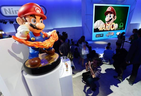 A Mario amiibo figurine on display at the Nintendo booth at the 2014 Electronic Entertainment Expo.
