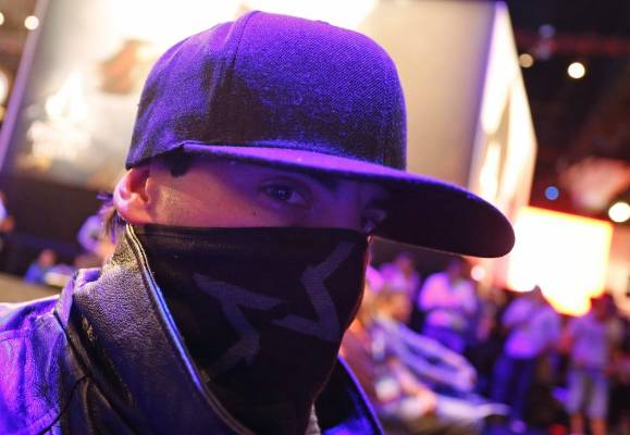 A man dressed as the main character from Watch Dogs poses at the Ubisoft booth at E3 2014.