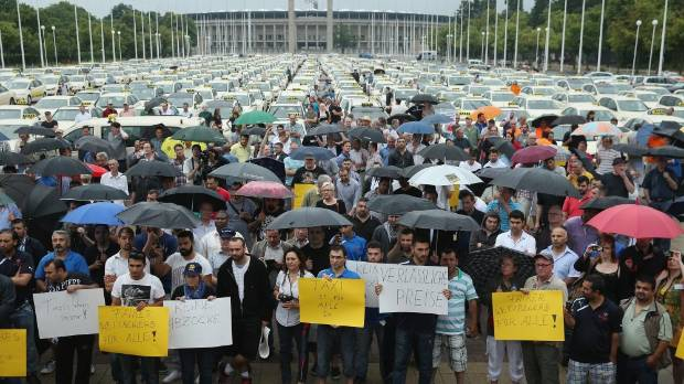Taxi drivers protest next to the Olympia Stadium in Berlin in June 2014.