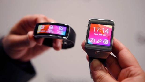 WATCHING THE CLOCK: Samsung's Gear 2 smartwatch and Gear Fit fitness band.