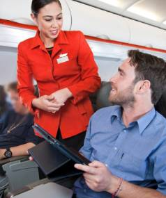 """BRING YOUR OWN: 87 per cent of travellers believe the """"bring your own device"""" policy saves airlines money and want ..."""