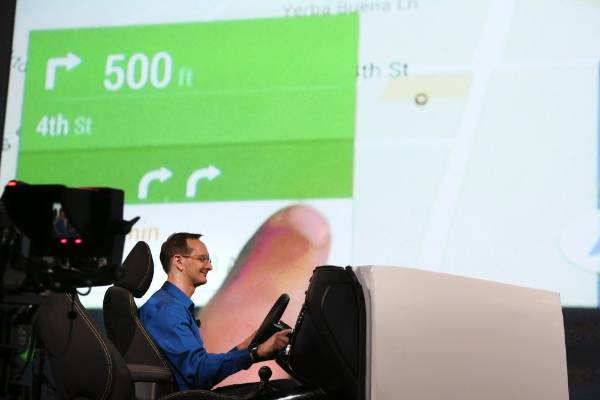 A Google employee demonstrates Android Auto onstage at the Google I/O developers conference in San Francisco.
