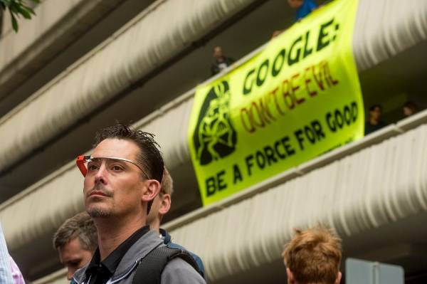 Wearing Google Glass, Klint Rudolph waits in line to attend the Google I/O developers conference in San Francisco as ...