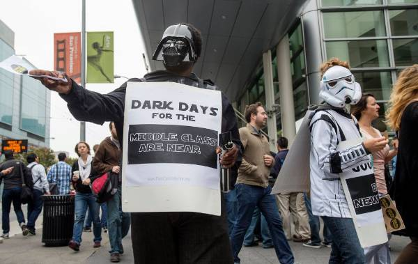 Dressed in Star Wars garb, Bryce Miller-Williams and Shandra Bernath-Plaisted protest outside the Google I/O developers ...
