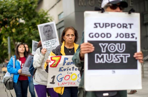 Rosa Penate pickets with other demonstrators outside the Google I/O developers conference in San Francisco.