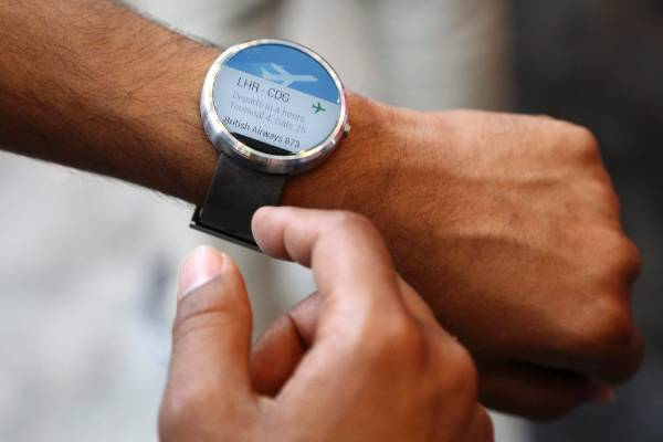 A Google employee demonstrates the features of the Moto smartwatch at the Google I/O developers conference.