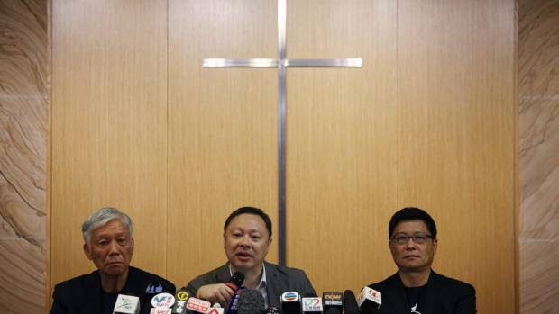 Founders of the so-called Occupy Central protest movement (left to right) Reverend Chu Yiu-ming, academic Benny Tai and ...