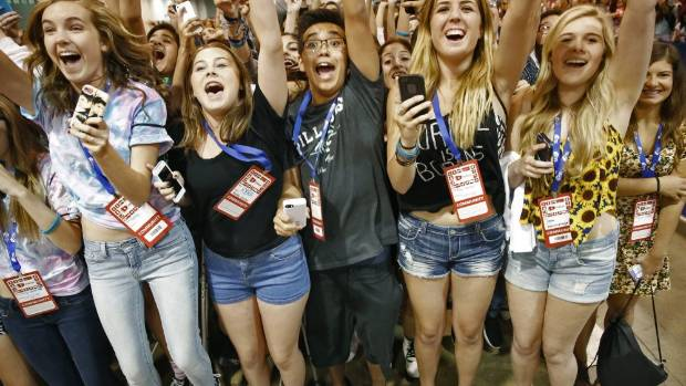 Exuberant young fans scream and wave at the appearance of Ricky Dillon, one of their YouTube heroes at VidCon 2014.