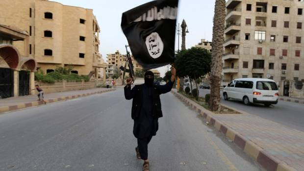 TERROR THREAT: A member of the Islamic State in Iraq and the Levant - the forerunner to the Islamic State - waves an ...
